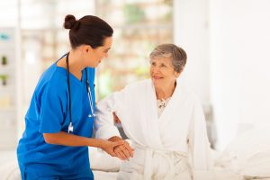 Home health care nurse with a patient