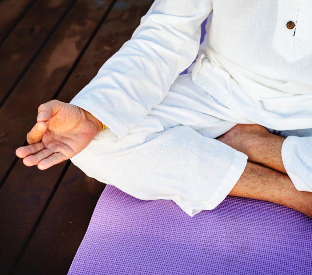 senior performing yoga